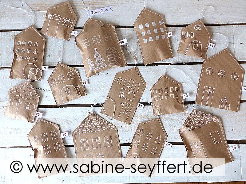 DIY Adventskalender selber machen, Haeuser aus Packpapier selber machen, Geschenk zu Weihnachten selber machen